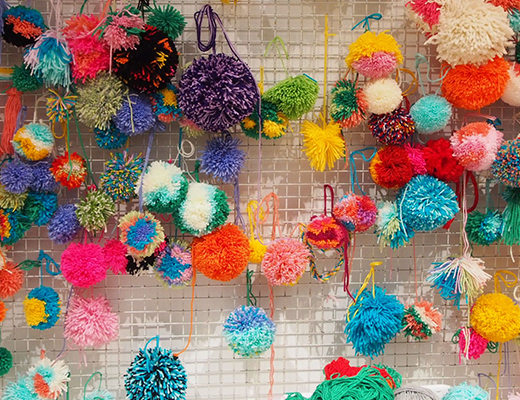 a wall of pompoms