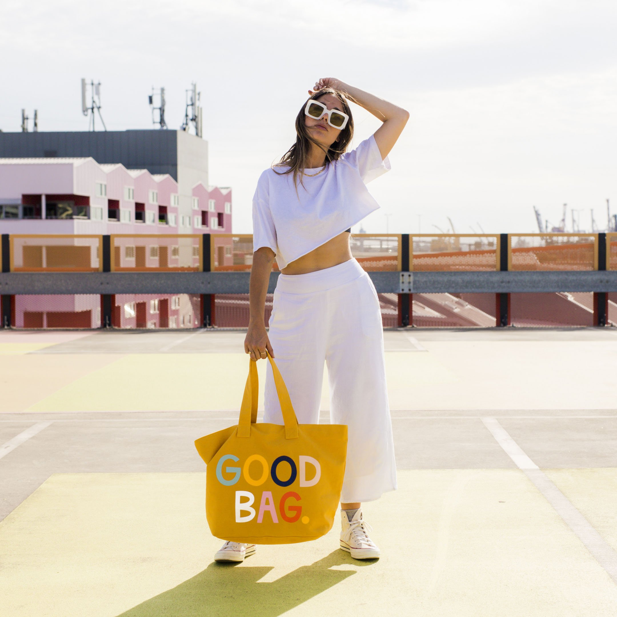 Mustard yellow tote with colourful text slogan that says GOOD BAG